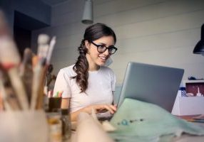 photo-of-woman-using-her-laptop-935756